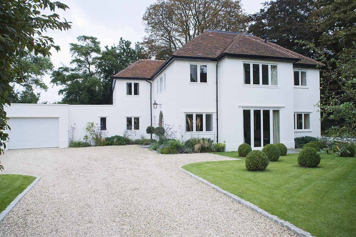 house in Sevenoaks white painted exterior with garden landscaping and pebble driveway by SevenoakStyle
