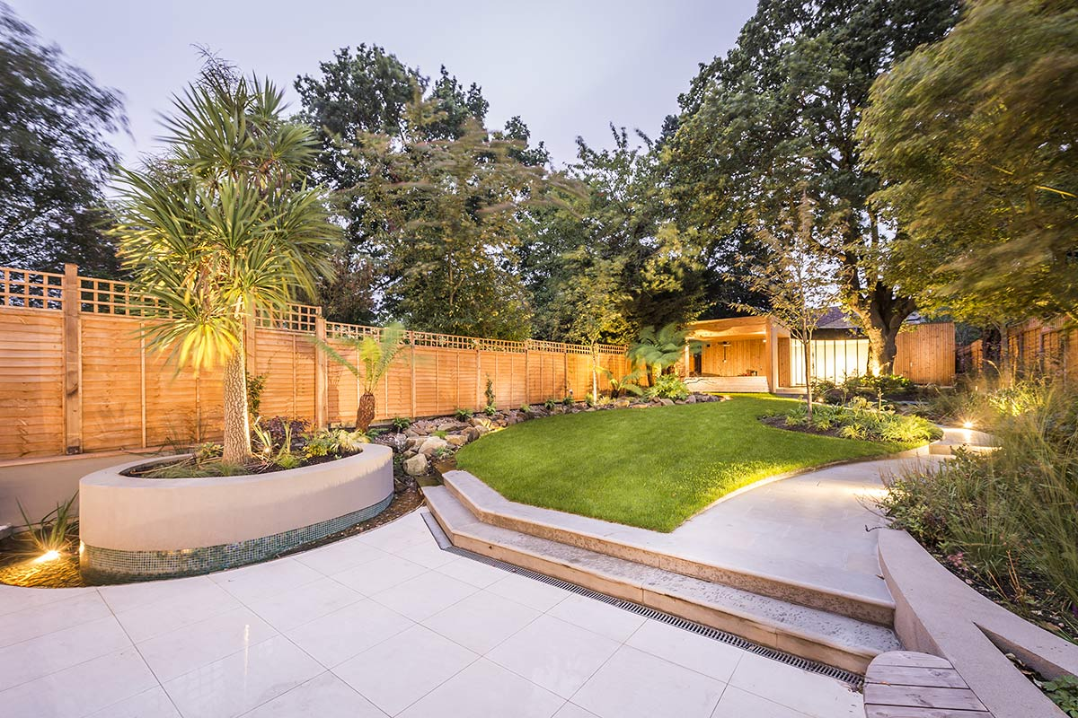landscaped garden in Sevenoaks Kent with a new patio, fencing and palm trees